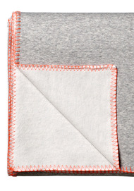 Grey throw with orange piping